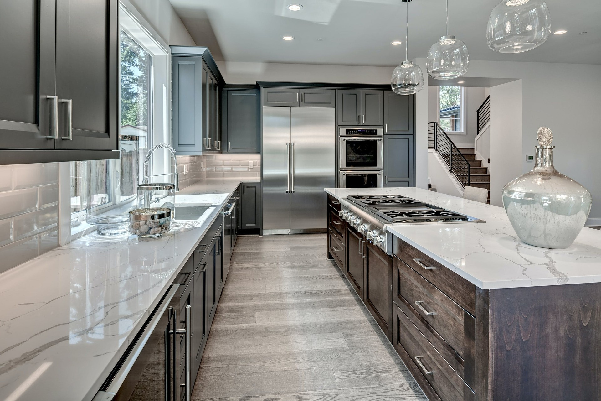 Hiring a kitchen remodeling contractor is a daunting task. It would help if you walked with a professional contractor-a person who is experienced in this line of work. Someone you will sit down with and explain all the things you need to give your kitchen a perfect look. The following are the tips you need to look out for when hiring a remodeling contractor for your kitchen. 1. Do your homework thoroughly Proper research is the first step when looking for a remodeling contractor. You will have a clear picture of what the result will look. Find out whether the contractor has ever handled a job of this scale. The contractors will give you a realistic budget on how much you will spend on your remodeling. 2. Interview multiple contractors You cannot work with the decision of one contractor. Find out from two or more contractors who seem capable of doing the work. As you conduct the interviews, you will be able to know their professionalism. 3. Get quotes After the interviews, ask them to provide you with the quotes for the project. The section should be inclusive of the cost of material for the remodeling contractor. Also, estimate the price of the number of labor hours. Lower costs do not mean the best pick. Also, consider available work samples and experience into account. 4. Consider a flexible contractor Hire a flexible enough contractor who will adjust to any changes that may arise from the original plan. 5. Make a proper plan Have a proper plan for your remodeling project. It will help you in ensuring that the project is started and carried out according to your preference. Defining the direction of your renovation project is essential. It gives your home a look that you had anticipated. 6. Online reviews and ratings Visit the potential contractor's website and look at his online reviews. You will be able to know what other customers who have worked with him before experienced. If the contractor has social media presence, visit their pages and learn more. Also, ch
